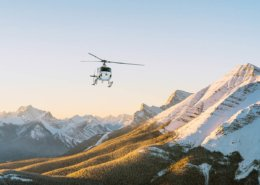 Helicopter over snowy Canadian Rockies